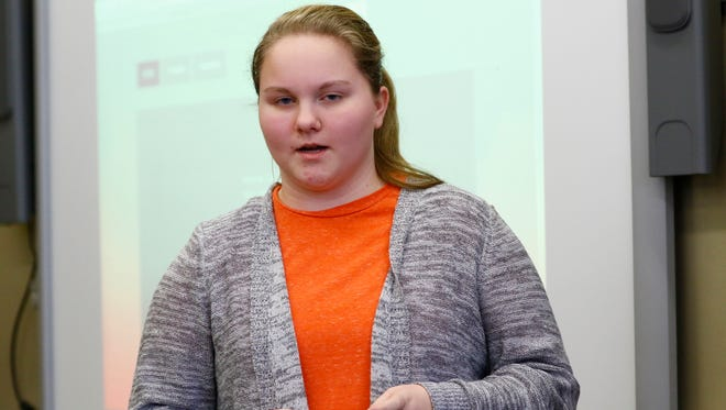 Eighth grader Zoe Anderson presents her sitting service in front of a group local business people Wednesday afternoon at D.C. Everest Junior High in Weston.