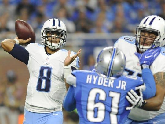 Titans quarterback Marcus Mariota (8) throws during the first half Sunday.