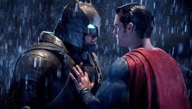 "Ben Affleck, left, and Henry Cavill confront each other in a scene from, ""Batman v Superman: Dawn of Justice."""