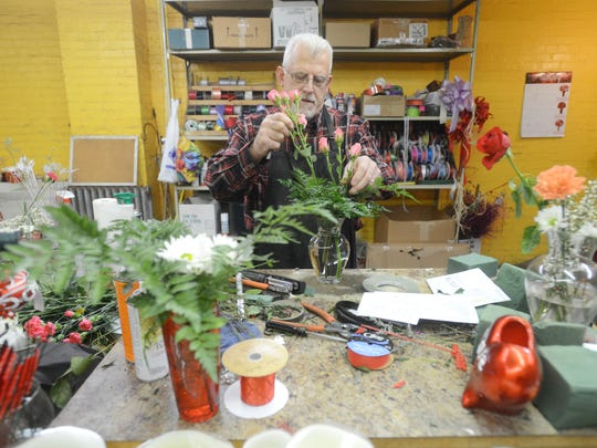 Dave Imlay creates a bouquet at Imlay Florists in Zanesville. Dave is the fifth generation of Imlays to run the company, which celebrates it's 175 anniversary this year.