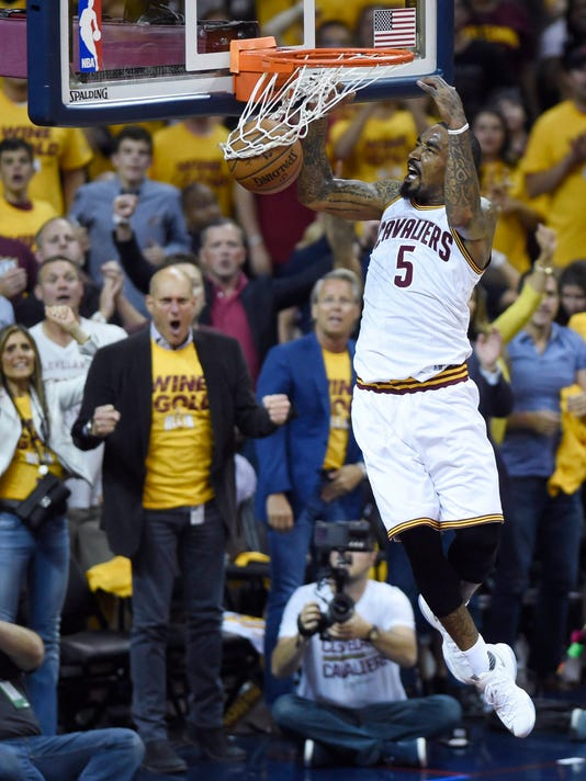FILE - In this May 25, 2016, file photo, Cleveland Cavaliers guard-forward J.R. Smith dunks against the Toronto Raptors during the first half of Game 5 of the NBA basketball Eastern Conference finals, in Cleveland. A person with direct knowledge of the negotiations says free agent Smith has agreed to a contract offer to return to the defending NBA champion Cavaliers. Smith has been waiting out of training camp with the Cavs but now has a deal in place, said the person who spoke to The Associated Press on Friday, Oct. 14, 2016, on condition of anonymity because the package has not been finalized. (Frank Gunn/The Canadian Press via AP, File)