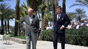 President John F. Kennedy meets with former President Dwight D. Eisenhower at Eisenhower's residence at Eldorado Country Club in Indian Wells on March 24, 1962.