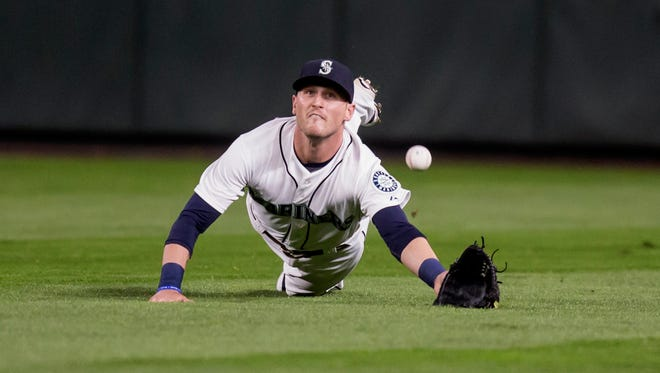 Seattle Mariners center fielder Shawn O'Malley dives for a fly ball by Colby Rasmus during the fourth inning of a baseball game Wednesday, Sept. 30, 2015, in Seattle.