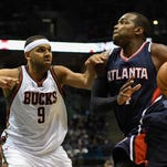 Atlanta Hawks forward Paul Millsap (4) drives for the basket against Milwaukee Bucks guard Jared Dudley (9) in the fourth quarter at BMO Harris Bradley Center. Millsap scored 23 points to help the Hawks beat the Bucks 97-86. Mandatory Credit: