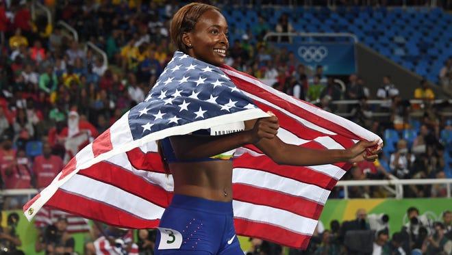 Dalilah Muhammad (USA) celebrates her victory in the 400 hurdles.