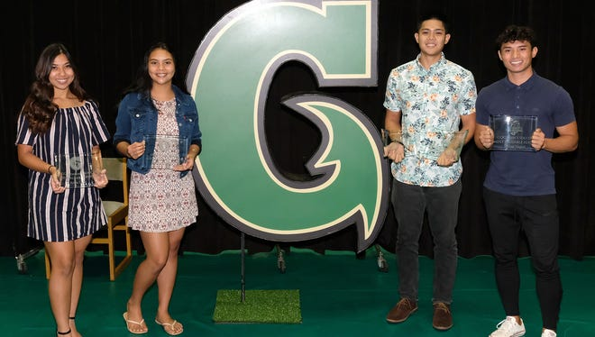 The University of Guam gave out Most Valuable Player awards to athletes in four sports on May 21 at the UOG Calvo Field House. From left: Ariya Cruz, women's socce; Sam Duenas, women's volleyball; Andrew Carlos, men's basketball; and Dylan Naputi, men's soccer.