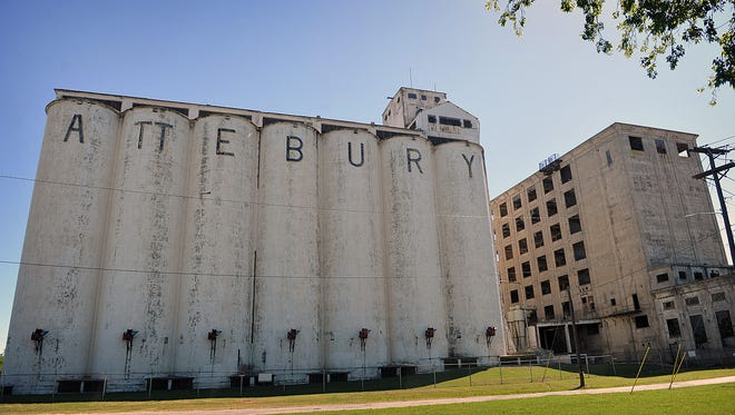 The Attebury Grain elevator business stands next to the vacant General Mills building at the corner of Kell east and Burnett.