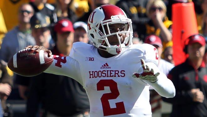 Indiana Hoosiers quarterback Chris Covington (2) passes against the Iowa Hawkeyes at Kinnick Stadium.