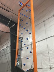 The rock climbing face-off wall at Air Madness Trampoline