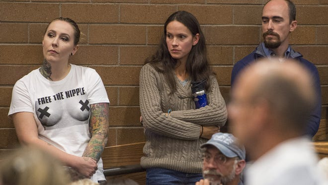 Samantha Six, a Free the Nipple supporter, left, at a Fort Collins City Council meeting to argue against a ban on female toplessness. Her case was heard by a federal appeals court Wednesday.