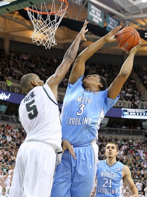 North Carolina Tar Heels forward Kennedy Meeks (3) shoots over Michigan State Spartans center Adreian Payne (5) during the 1st half a game at Jack Breslin Student Events Center.