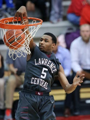 Lawrence Central's Mario Nalls slam dunks the ball over the Roncalli defense in the second half of the IHSAA Boys Basketball Sectional #10 held at Lawrence Central High School on Tuesday, Mar. 3, 2015. Lawrence Central won 68-54.