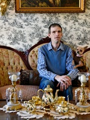 "Robert Snyder, 40, a manager at a fast food restaurant, sits for a portrait at his home in York. Snyder has used Vivitrol, a monthly, non-addictive injection, to help him in the recovery process for alcohol dependence. He called the medication a very helpful tool. ""Some people say, 'It will change my life.' No, you're going to save your own life,"" he said. ""The Vivitrol is just a security blanket, until you're able to get support."""