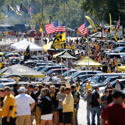 Fans tailgate prior to kickoff against Wisconsin on Saturday, Nov. 2, 2013, at Kinnick Stadium in Iowa City as the fall leaves add color to the setting. (Bryon Houlgrave/The Des Moines Register)