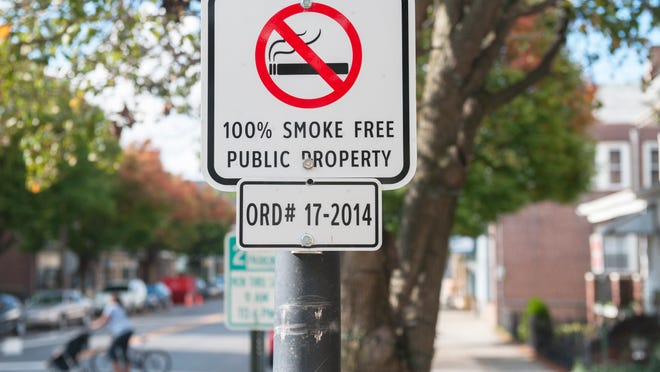 A no-smoking sign is posted on Monmouth Street in Gloucester City, where a precedent-setting smoking ban was enacted recently.