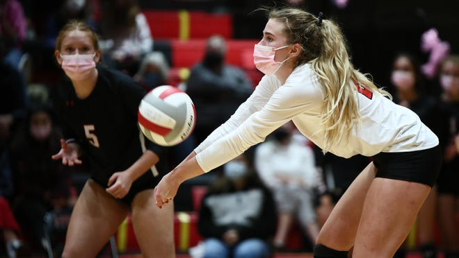 Lake Travis libero Mackenzie Cude passes the ball against Austin High as Abby Teel looks on Oct. 27 at Lake Travis High School. Lake Travis won the match over Austin High in straight sets to remain unbeaten.