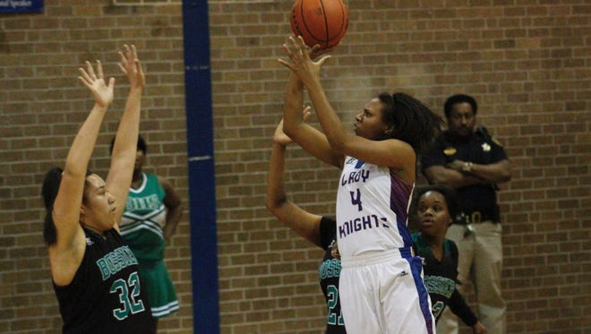 Woodlawn's Margo Pleze (4) goes up for a bucket over Bossier's Quienna White during Thursday's first-round LHSAA Class 4A state playoff game.