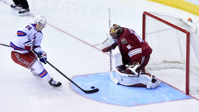 Feb 14, 2015:New York Rangers left wing Chris Kreider (20) scores on Arizona Coyotes goalie Mike Smith (41) during the second period at Gila River Arena.