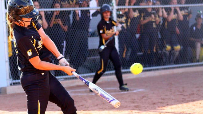 Alamogordo junior Courtney Grubbs makes contact with the ball Friday afternoon at Volcano Vista High School.