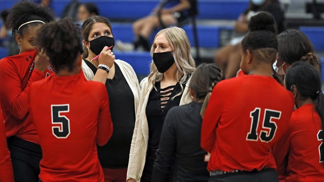 Brownfield coach Mallory Ellis talks to her players during a season-opening road match against Estacado. The Lady Cubs secured the 25-14, 25-6, 25-6 victory, the first for Ellis a Brownfield alum.