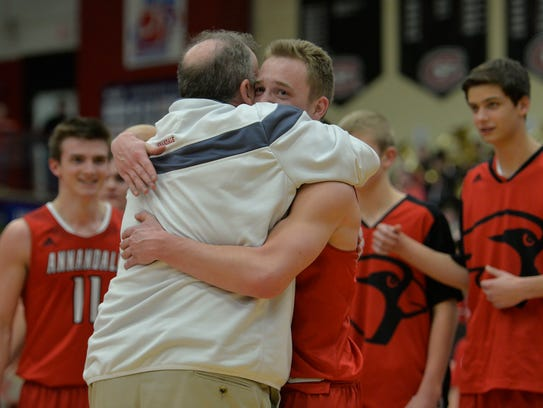 "Annandale's Brock Fobbe (3) hugs head coach Don ""Skip"""