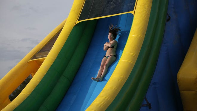 Two waterslides at Slide Across America have a drop of 40 feet or more. There will be more than 50 attractions at the Aug. 7-8 event at Salt River Fields.