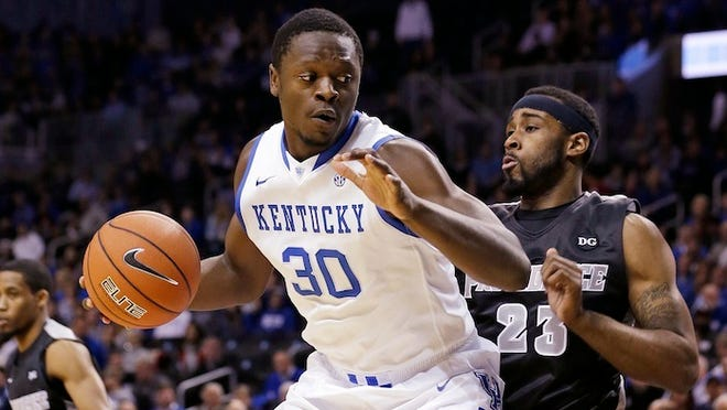 Providence's LaDontae Henton (23) defends Kentucky's Julius Randle (30) during the first half of an NCAA college basketball game Sunday, Dec. 1, 2013, in New York. (AP Photo/Frank Franklin II)