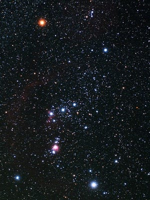 """This cropped picture of the constellation Orion the Hunter was taken in November 2010. Betelgeuse appears bright at the upper left. Bellatrix is at upper right, the brilliant star Rigel is at lower right and Saiph at lower left. The three stars of Orion's """"Belt"""" are in the center, and a line of stars and the Great Nebula of Orion make up Orion's """"Sword"""" below the Belt. [Photo by TheStarmon (Own work) [CC BY-SA 3.0 (https://creativecommons.org/licenses/by-sa/3.0)], via Wikimedia Commons]"""