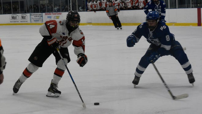 Brother Rice forward Keaton Vogel (14) shown playing earlier this year in the Trenton Hockey Showcase.