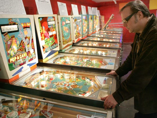 Dennis Diken of the Smithereens playing pinball at the Silverball Museum in Asbury Park in 2009.
