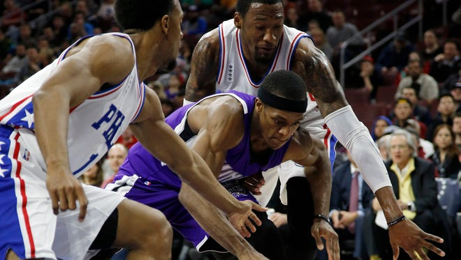 Sacramento Kings' Rajon Rondo, center, chases after a loose ball between Philadelphia 76ers' Ish Smith, left, and Robert Covington during the first half Wednesday.
