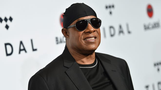 "FILE - In this Oct. 17, 2017 file photo, Stevie Wonder attends the TIDAL X: Brooklyn 3rd Annual Benefit Concert in New York.  Wonder says he plans to play a series of shows in the coming months to celebrate life, love and music and push back against troubled times. He gave no specifics other than saying shows in Las Vegas will be in the mix, and that he also hopes to have his long-in-the-works album ""Through The Eyes of Wonder"" done before 2018 ends."