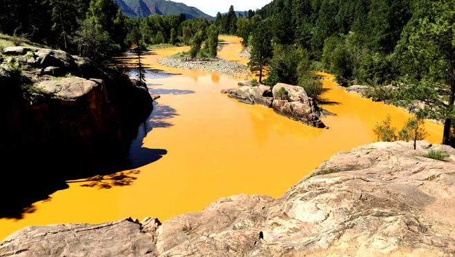 Mine waste from the Gold King Mine north of Silverton fills the Animas River at Bakers Bridge.