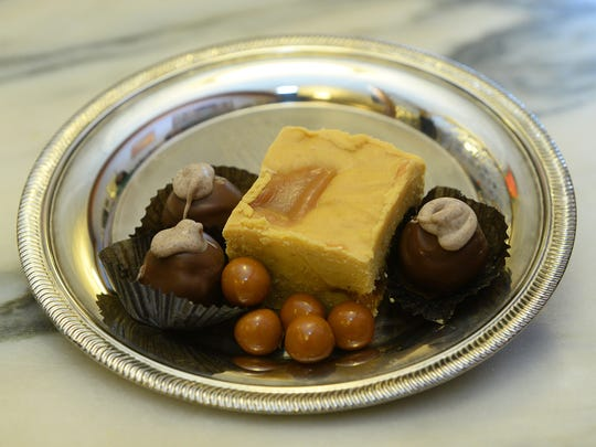 Pumpkin spice truffle, pumpkin caramel balls and pumpkin caramel fudge at Candy Masterpiece.