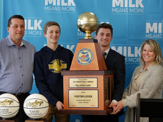 Foster Loyer of Clarkston High School, third from left poses for a photograph with his family, from left father John Loyer, brother Fletcher Loyer and mother Katie Loyer after receiving the 38th annual Hal Schram Mr. Basketball award given by the Basketball Coaches Association of Michigan in Detroit on Monday, March 19, 2018.