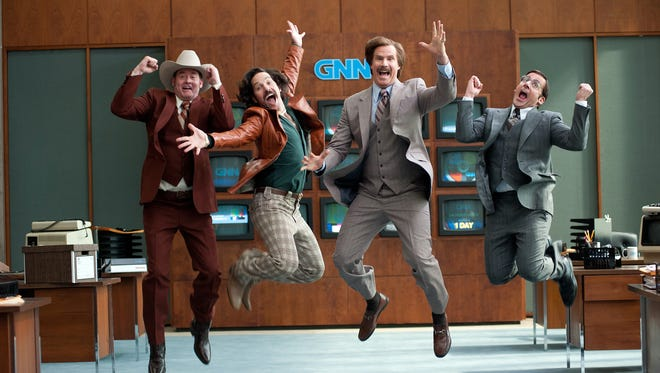 The gang is back! Left to right: David Koechner as Champ Kind, Paul Rudd as Brian Fantana, Will Ferrell as Ron Burgundy and Steve Carell as Brick Tamland in 'Anchorman 2: The Legend Continues.'