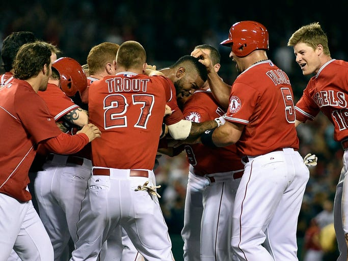 Aug. 28: The Los Angeles Angels celebrate a sacrifice fly hit by second baseman Howie Kendrick in the 10th inning against the Oakland Athletics at Angel Stadium of Anaheim.