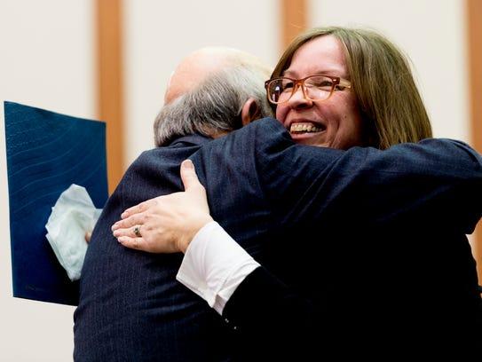 Carol Cavin of the US Probation Office hugs U.S. Magistrate