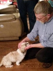 Jerry Gibbs welcomes his beloved shih tzu Tennessee