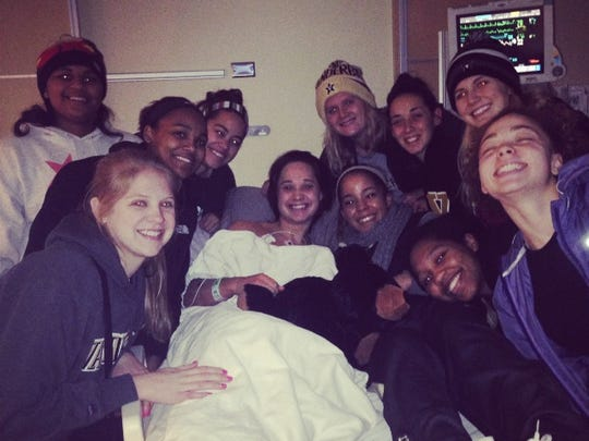 Rebekah Dahlman surrounded by members of the Vanderbilt basketball team while she was in the hospital.