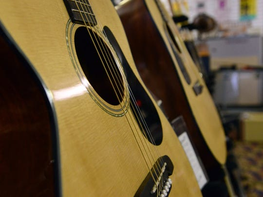 Guitars line the showroom floor of Signature Music in Lancaster. Owner Dick Evener plans to sell or close the store in the next year.
