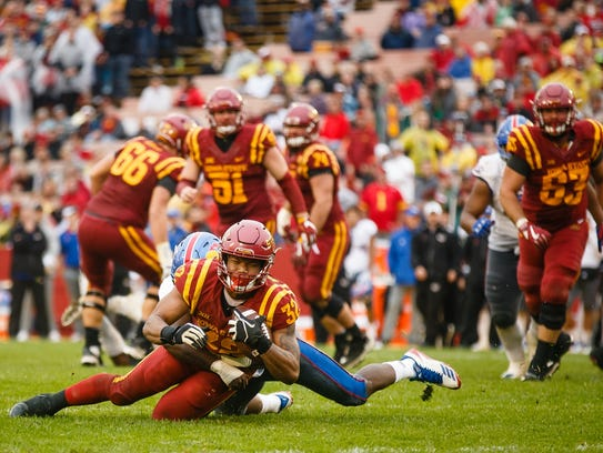 Sophomore running back David Montgomery (32) is tackled