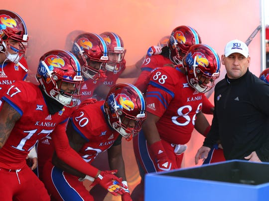 Kansas Jayhawks head coach David Beaty leads his team onto the field before the game against the Oklahoma Sooners last season.