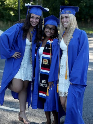 Logan Standridge, Celinette Perez, and Willow Golden pose for a photo before their graduation ceremony on Saturday, Aug. 1, 2020.