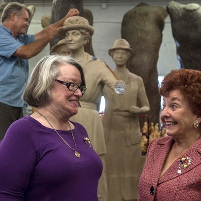From left, Paula F. Casey and Yvonne Wood chat while