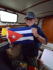 Boylan shows his Cuban courtesy flag, with a quarantine
