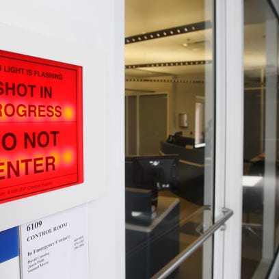 A sign informs of an experiment in progress of the Omega EP laser at the University of Rochester's Omega Laser Facility.