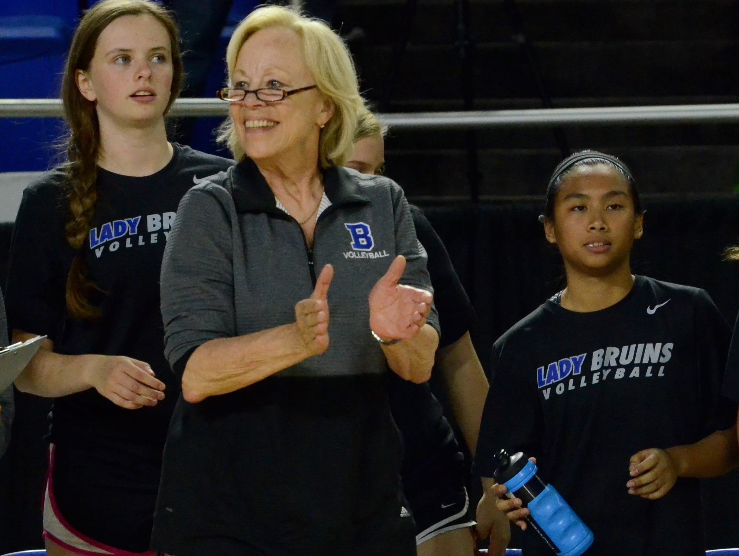 Brentwood coach Barbara Campbell encourages her team during Friday's Class AAA title match against Farragut.