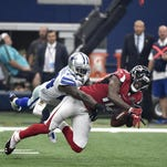 Dallas Cowboys cornerback Morris Claiborne (24) breaks up a pass intended for Atlanta Falcons wide receiver Julio Jones (11) during Sunday's game.