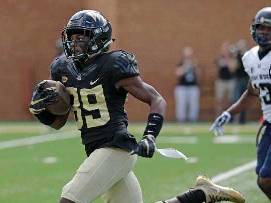 Wake Forest's Greg Dortch (89) runs for a touchdown after a catch against Utah State in the first half of an NCAA college football game in Winston-Salem, N.C., Saturday, Sept. 16, 2017. (AP Photo/Chuck Burton)